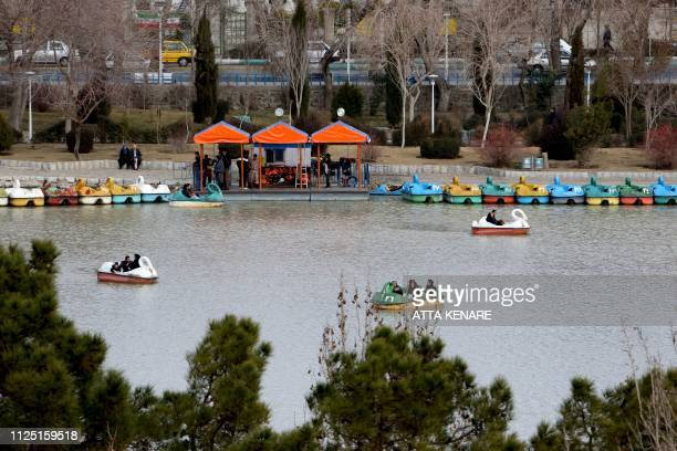 Iranians ride pedalo in Isfahan, on February 16, 2019.