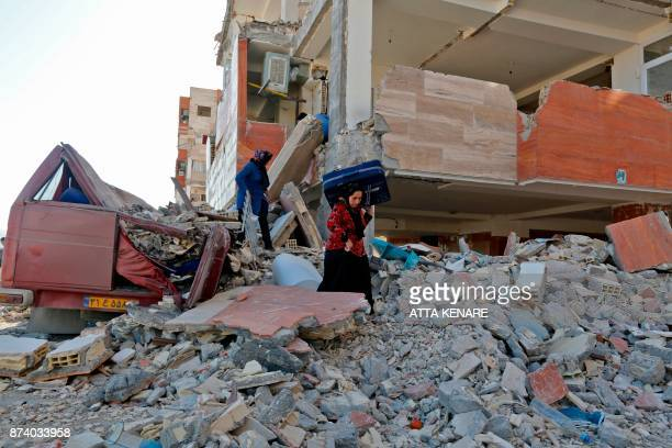Iranians salvage items from damaged buildings in the town of Sarpole Zahab in the western Kermanshah province near the border with Iraq on November...
