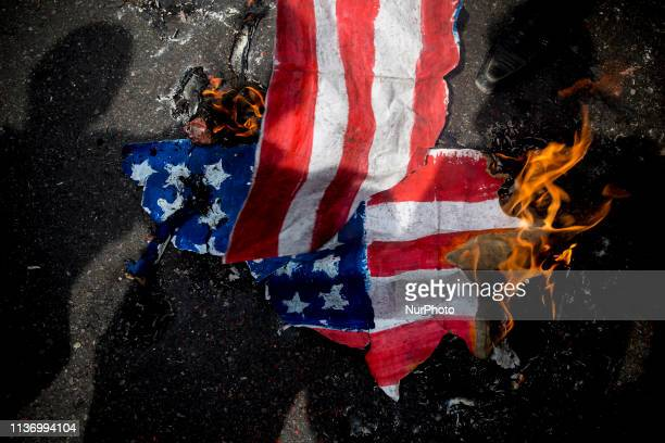 Iranians set ablaze a US flag during an antiUS rally following Friday prayers in Tehran on April 12 2019 The US government on 08 April 2019 said it...