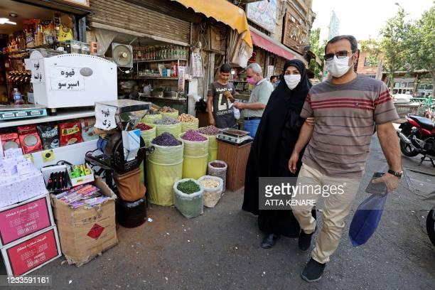 Iranians shop at the Molavi bazaar in southern Tehran on June 20, 2021.