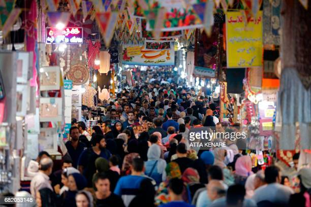 Iranians shop in the Grand Bazaar in southern Tehran's Molavi neighbourhood on May 11 2017 In a working class district of southern Tehran teeming...