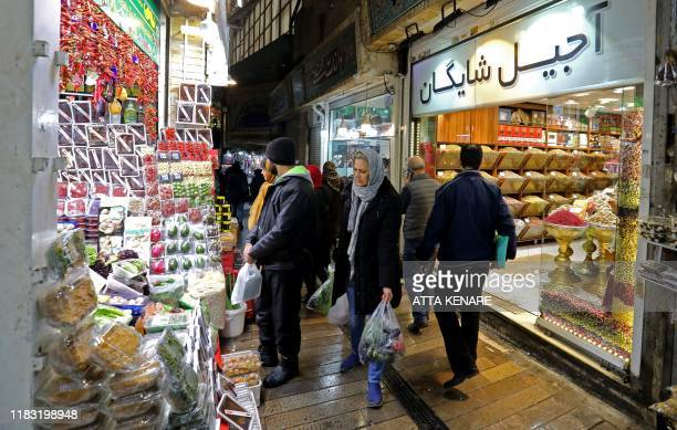 Iranians shop in the Tajrish Bazaar in the capital Tehran on November 18 2019 Iran has slammed a US show of support for rioters after violent...