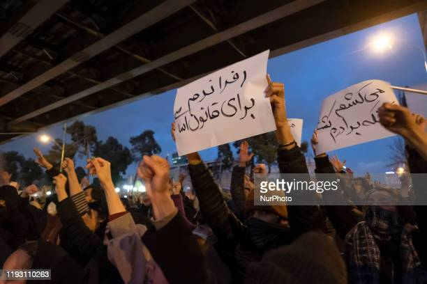 Iranians shout slogans as some of them holdup placards with Persian scripts that read I will kill who killed my brother and Constitutional referendum...