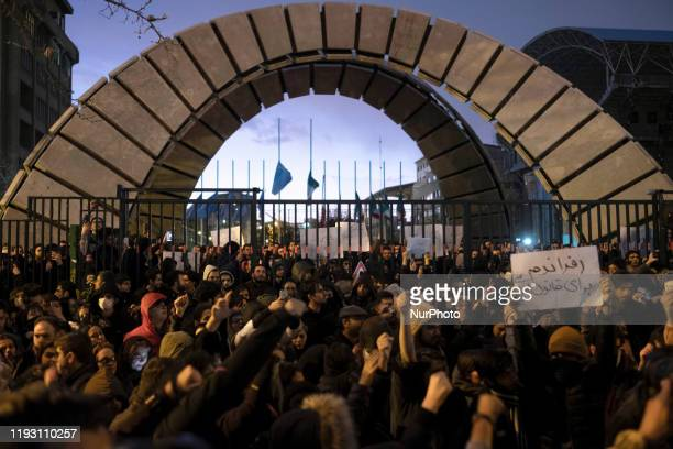 Iranians shout slogans as they gather in front of a University to light candles in memory of the victims of the Ukraine Boeing 737 passenger plane in...