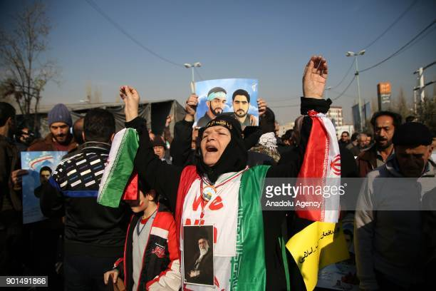 Iranians shout slogans during a protest after performing the Friday Prayer at Imam Khomeini Mosque following US' statement about backing the...