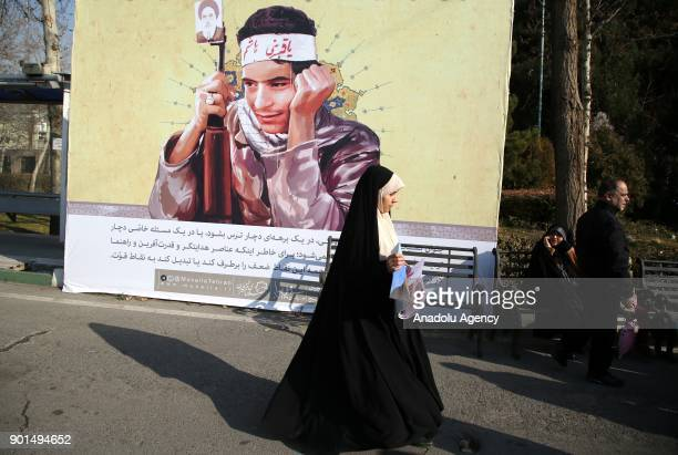Iranians stage a demonstration after US' statement about backing the antigovernment protests in Tehran Iran on January 05 2018