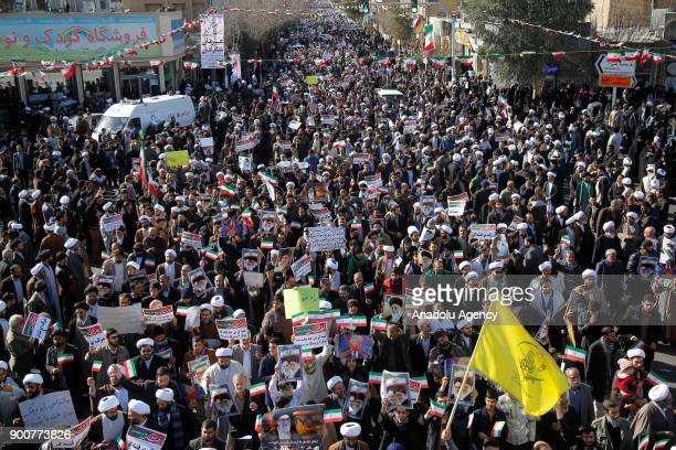 Iranians take part during a stateorganized rally against antigovernment protests in the country in Qom Iran on January 3 2017
