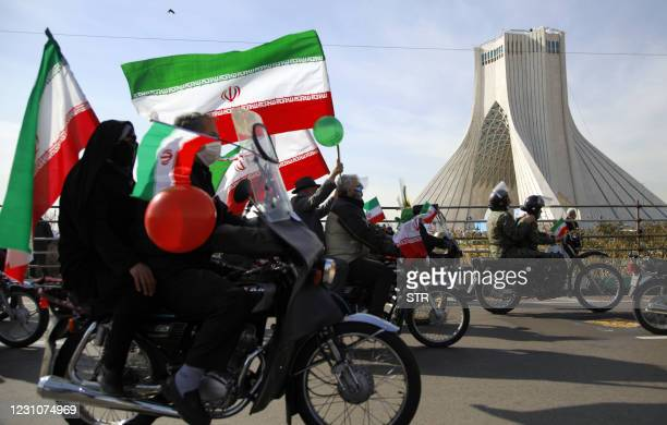 Iranians take part in a ceremony marking the 42nd anniversary of the 1979 Islamic Revolution, at the Azadi square in Tehran, on February 10, 2021.
