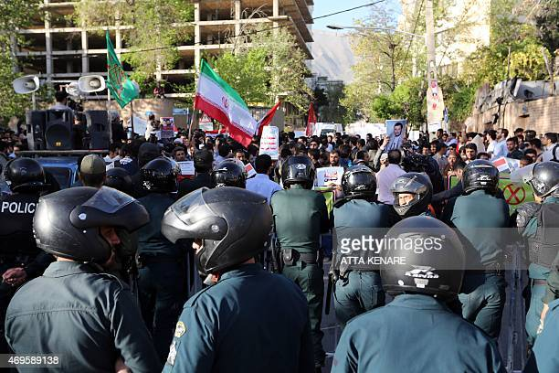 Iranians take part in a demonstration against the Saudiled coalitions Operation Decisive Storm against the Huthi rebels in Yemen outside the Saudi...