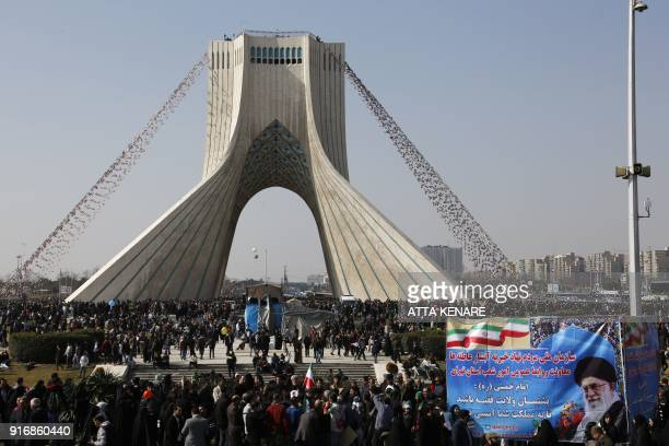 Iranians take part in a rally marking the anniversary of the 1979 Islamic revolution, on February 11, 2018 in the capital Tehran. - President Hassan...