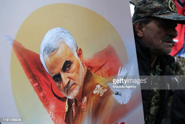 Iranians take part in an anti-US rally to protest the killing of Iranian Revolutionary Guards' Quds Force commander Qasem Soleimani by a US airstrike...
