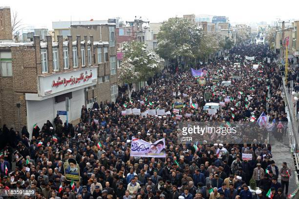 Iranians take to the streets in support of the Islamic republic's government and supreme leader Ayatollah Ali Khamenei in the cenral city of Arak...