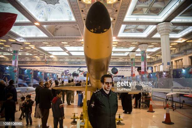 Iranians visit a weaponry and military equipment exhibition in Tehran Iran on February 07 2019 organized on the occasion of the 40th anniversary of...