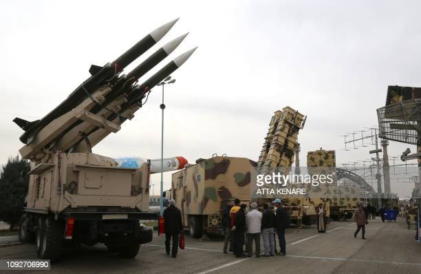 Iranians visit a weaponry and military equipment exhibition in the capital Tehran on Febraury 2 organised on the occasion of the 40th anniversary of...