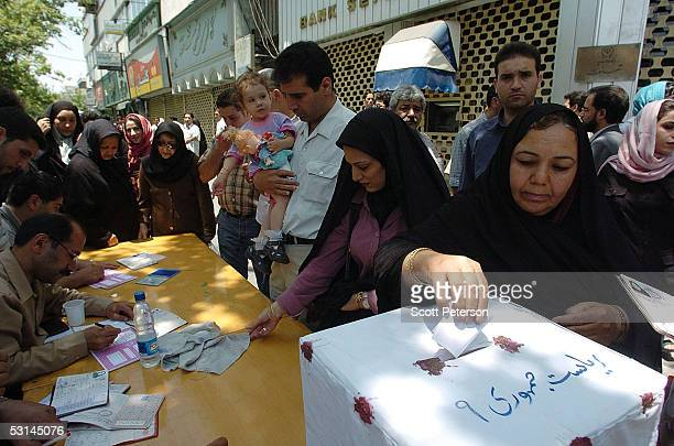 Iranians vote at an outdoor polling station during the secondround presidential runoff election June 24 2005 in Tehran Iran Ali Akbar Hashemi...