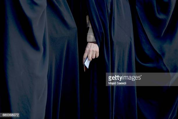 Iranians vote in the twelfth presidential election on May 19 2017 in the city of Qom south of the capital Tehran Iran Iranians began voting Friday in...