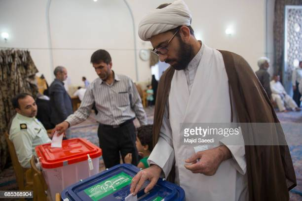 Iranians vote in the twelfth presidential election on May 19, 2017 in the city of Qom, south of the capital Tehran, Iran. Iranians began voting...