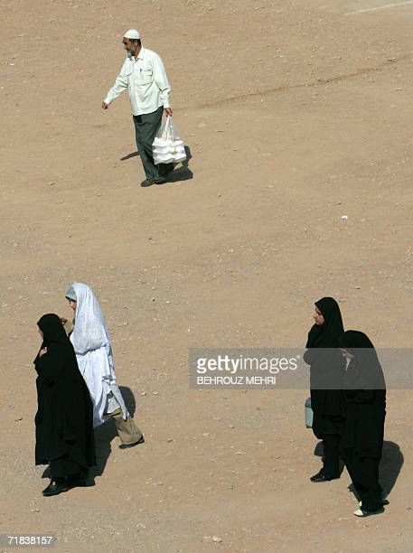 Iranians walk in the courtyard of the Jamkaran mosque outside the religious city of Qom 120 kms south of Tehran 08 September 2006 Hundreds of...