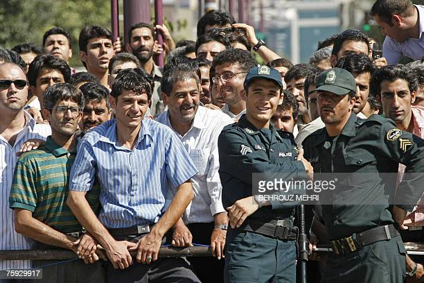 Iranians watch the execution of Hossein Kavousifar and Majid Kavousifar who were hanged in public in central Tehran 02 August 2007 Two men convicted...
