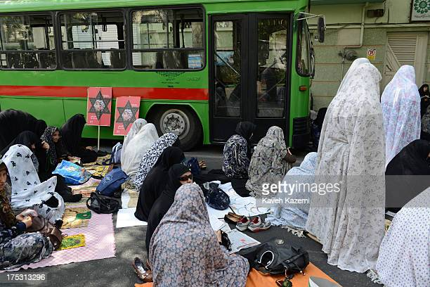 Iranians women participating in demonstrations during Iran's 'International Quds Day' take their positions for Friday prayers outside Tehran...