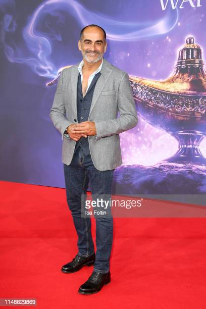 IranianUS actor Navid Negahban attends the movie premiere of Aladdin at UCI Luxe Mercedes Platz on May 11 2019 in Berlin Germany