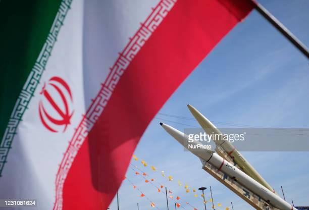 Iran-made, Dezful medium range ballistic missile and Zolfaghar road-mobile single-stage solid-propelled liquid fueled missile are seen next to an...