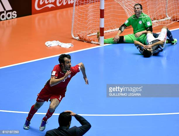 Iran's Ahmad Esmaeilpour celebrates after scoring and leading his team to victory over Paraguay during their Colombia 2016 FIFA Futsal World Cup...