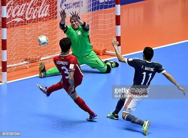 Iran's Ahmad Esmaeilpour scores leading his team to victory over Paraguay during their Colombia 2016 FIFA Futsal World Cup quaterfinal match in...