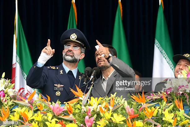 Iran's Air Force commander brigadier general Ahmad Meighati speaks with Iranian President Mahmoud Ahmadinejad during the annual army day military...