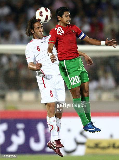 Iran's Ali Karimi and Indonesia's Bambang Pamungkas jump to head the ball during their 2014 World Cup Asian zone qualifying football match at Azadi...