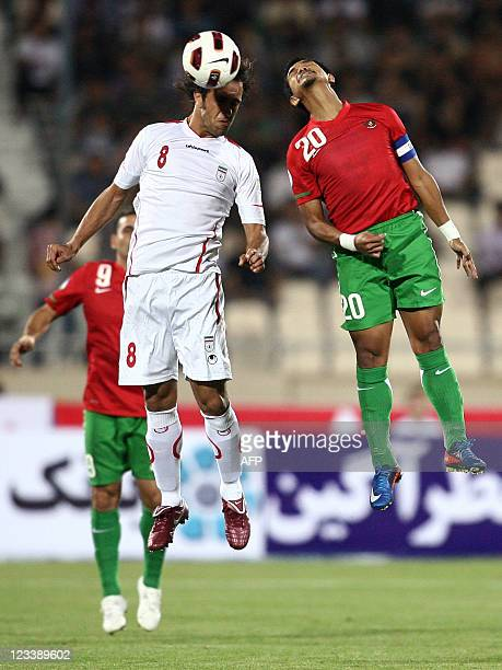 Iran's Ali Karimi jumps with Indonesia's Bambang Pamungkas to head the ball during their 2014 World Cup Asian zone qualifying football match at Azadi...
