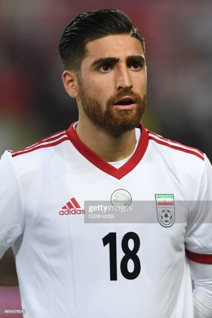 HOMBRES!!!!!!!! De vuelta a Venezuela :D Irans-alireza-jahanbakhsh-looks-on-prior-to-the-friendly-football-picture-id963457604