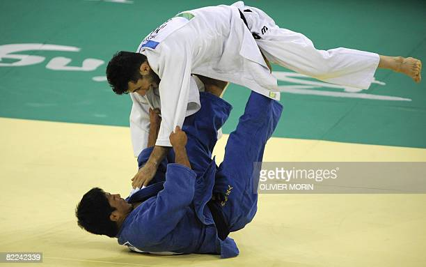 Iran's Arash Miresmaeili and Japan's Masato Uchishiba compete during their men's 66kg match of the 2008 Beijing Olympic Games on August 10 2008 in...