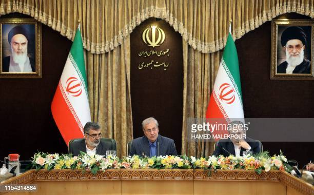 Iran's Atomic Energy Organisation spokesman Behrouz Kamalvandi, government spokesman Ali Rabiei, and Deputy Foreign Minister Abbas Araghchi give a...
