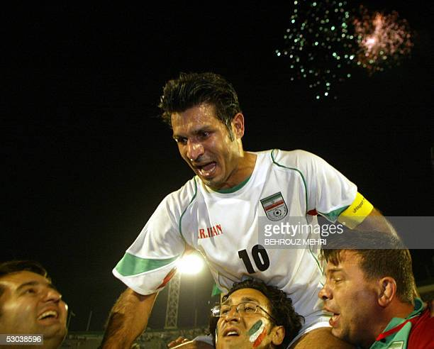 Iran's captain Ali Daei celebrates on the shoulders of Iranian civilians after Iran won its 2006 World Cup qualifier game against Bahrain and secured...