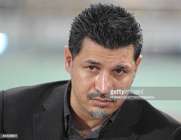 Iran's coach Ali Daei watches the match against Thailand in the 2011 Asian Cup qualifier at Rajamangala stadium in Bangkok on January 28 2009 AFP...