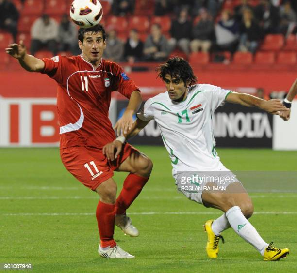 Iran's defender Ehsan Hajsafi vies for the ball with Iraq's forward Alaa Abdulzahra during their 2011 Asian Cup group D football match in the Qatari...