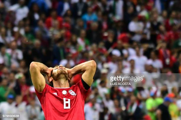 Iran's defender Morteza Pouraliganji reacts after defeat during the Russia 2018 World Cup Group B football match between Iran and Spain at the Kazan...