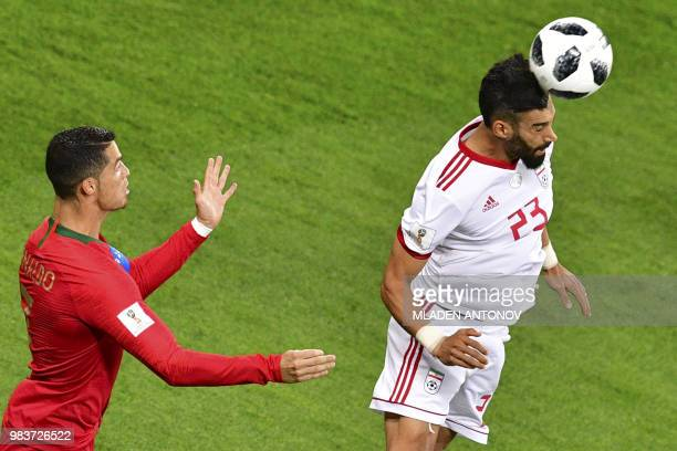 Iran's defender Ramin Rezaian and Portugal's forward Cristiano Ronaldo vie for the ball during the Russia 2018 World Cup Group B football match...