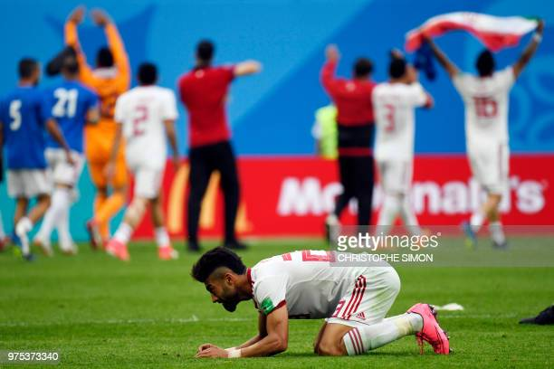 Iran's defender Ramin Rezaian celebrates at the end of the Russia 2018 World Cup Group B football match between Morocco and Iran at the Saint...