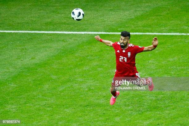 Iran's defender Ramin Rezaian heads the ball during the Russia 2018 World Cup Group B football match between Iran and Spain at the Kazan Arena in...