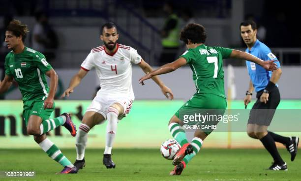 Iran's defender Roozbeh Cheshmi fights for the ball against Iraq's midfielder Safaa Hadi AlFuraiji during the 2019 AFC Asian Cup group D football...