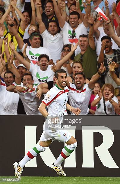 Iran's Ehsan Haji Safi celebrates after scoring against Bahrain during their football match at the AFC Asian Cup in Melbourne on January 11 2015 AFP...