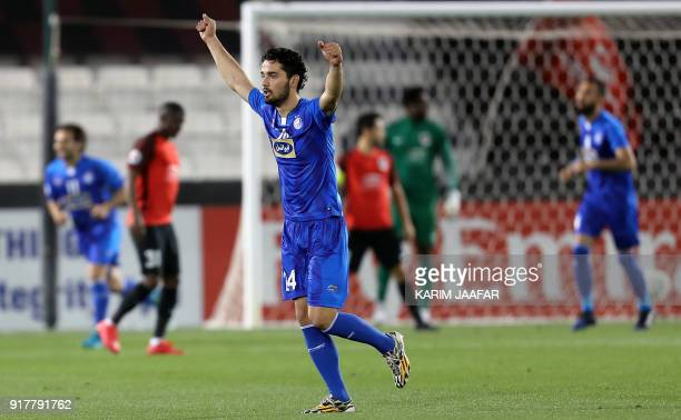 Iran's Esteghlal FC's Iranian midfielder Omid Noorafkan celebrates after Qatar's AlRayyan SC scored an own goal during their Asian Champions League...