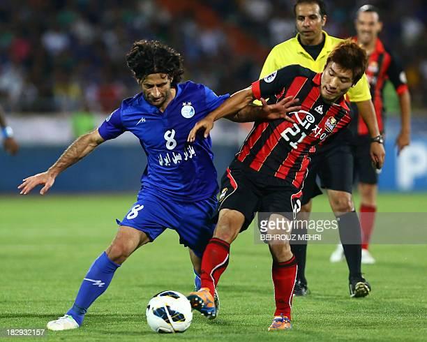 Iran's Esteghlal midfielder Pejman Nouri dribbles past South Korea's FC Seoul defender Ko YoHan during their AFC Champions League SemiFinal football...
