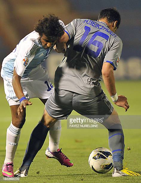 Iran's Esteghlal player Hashem Beikzadeh vies for the ball with Saudi's al-Hilal player Alshamrani during their AFC Champions League group D football...