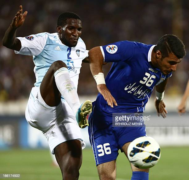 Iran's Esteghlal player Iman Moussavi and Saudi Arabia's AlHilal Sultan alBeshi fight for the ball during their AFC Champions League group D football...