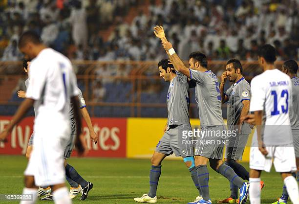 Iran's Esteghlal players celebrate after scoring a goal against Saudi's al-Hilal club during their AFC Champions League group D football match at the...