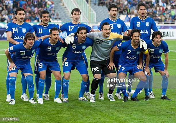 Iran's Esteghlal players pose before an AFC Champions League group B football match against Uzbekistan's Pakhtakor at Azadi stadium in Tehran on...