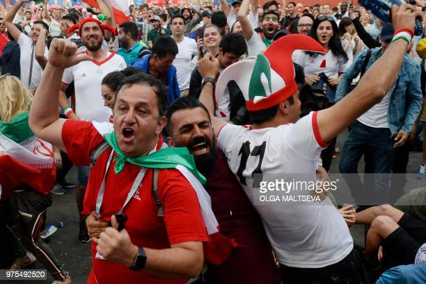 Iran's fans with Iranian national flag celebrate the victory after Russia 2018 World Cup Group B football match between Iran and Morocco at the Fifa...